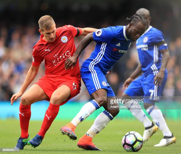 Leicester City's Marc Albrighton and Chelsea's Victor Moses battle for the ball