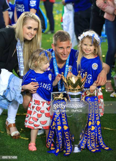 Leicester City's Marc Albrighton and family pose with the Barclays premier League trophy