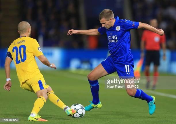 Leicester City's Marc Albrighton and FC Porto's Felipe Andre Andre battle for the ball