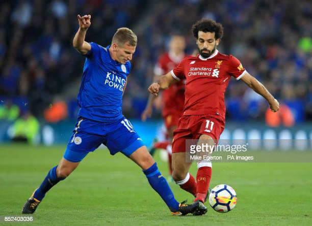 Leicester City's Marc Albrighton and Liverpool's Mohamed Salah battle for the ball during the Premier League match at King Power Stadium Leicester