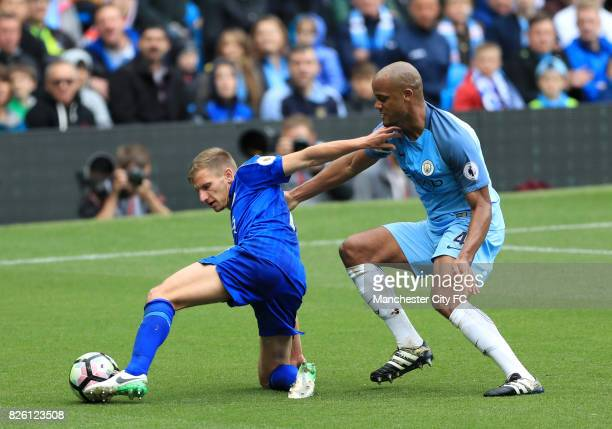 Leicester City's Marc Albrighton and Manchester City's Vincent Kompany battle for the ball