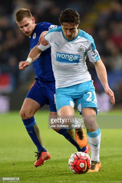 Leicester City's Marc Albrighton and Newcastle United's Daryl Janmaat battle for the ball