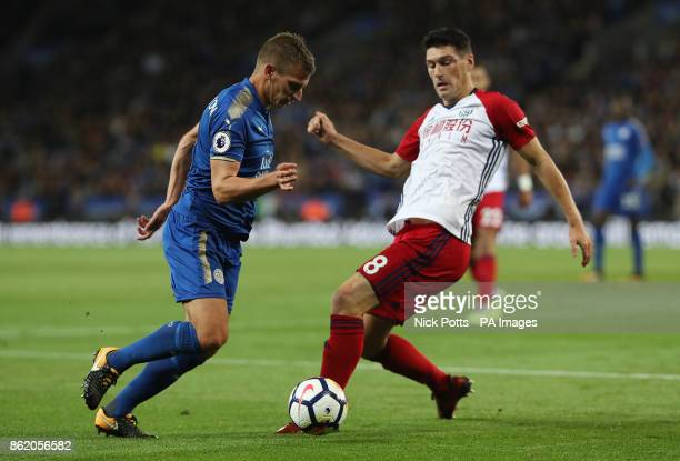 Leicester City's Marc Albrighton and West Bromwich Albion's Gareth Barry battle for the ball during the Premier League match at the King Power...