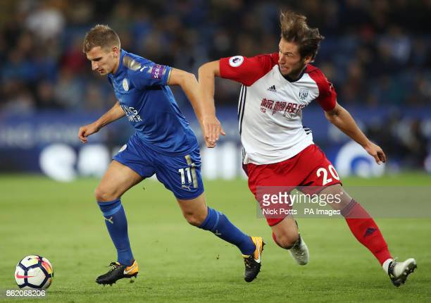 Leicester City's Marc Albrighton and West Bromwich Albion's Grzegorz Krychowiak battle for the ball during the Premier League match at the King Power...