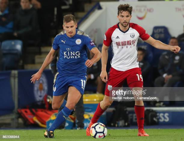 Leicester City's Marc Albrighton and West Bromwich Albion's Jay Rodriguez during the Premier League match between Leicester City and West Bromwich...