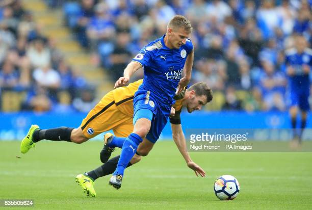 Leicester City's Marc Albrighton battles with Brighton Hove Albion's Pascal Gross during the Premier League match at the King Power Stadium Leicester