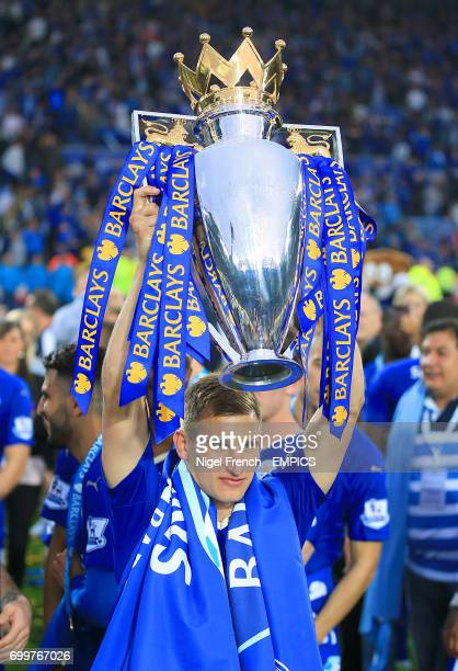 Leicester City's Marc Albrighton lifts the Barclays Premier League trophy