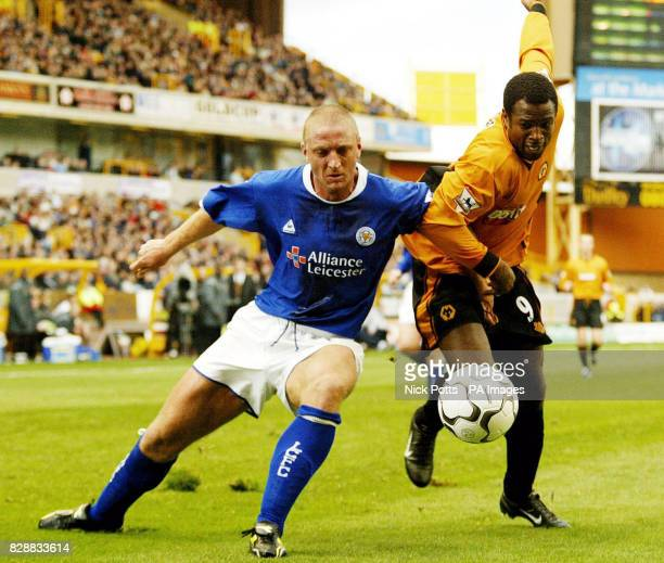 Leicester City's Matt Elliott tussles for the ball with Wolverhampton Wanderers striker Nathan Blake during their Barclaycard Premiership match at...