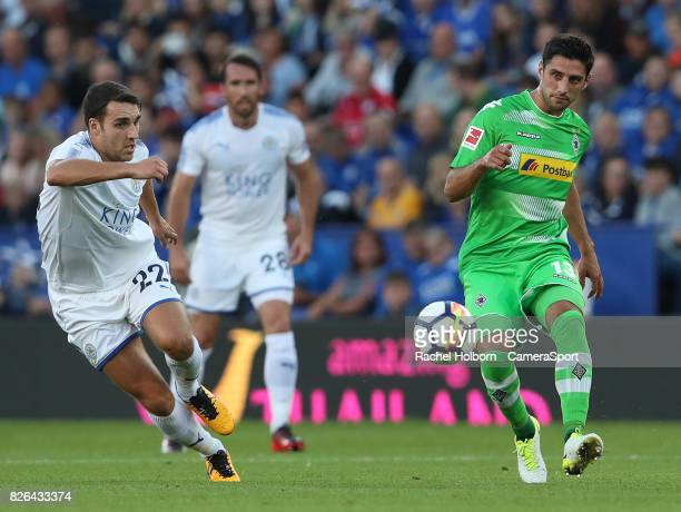 Leicester City's Matthew James and Borussia Monchengladbach's Lars Stindl during the preseason friendly match between Leicester City and Borussia...