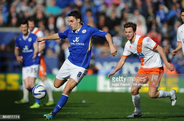 Leicester City's Matty James and Blackpool's Andy Halliday battle for the ball during the Sky Bet Championship match at the King Power Stadium...