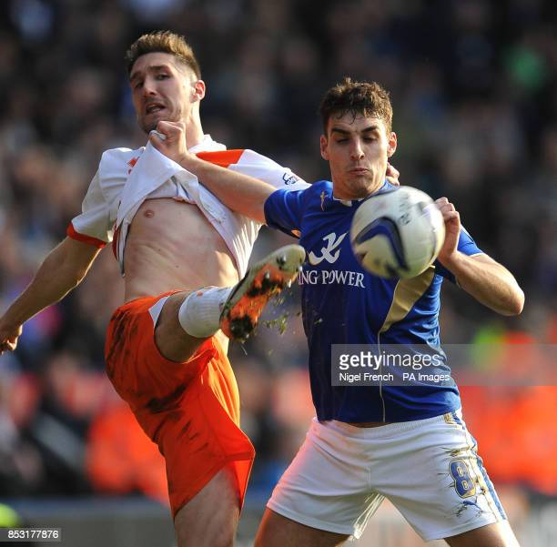 Leicester City's Matty James and Blackpool's Chris Basham battle for the ball during the Sky Bet Championship match at the King Power Stadium...