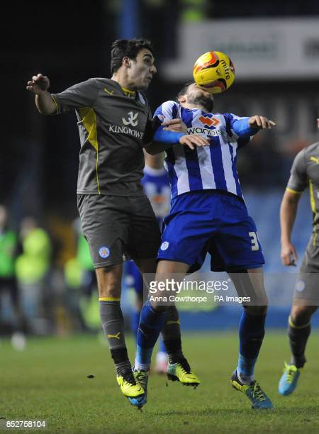Leicester City's Matty James and Sheffield Wednesday's Atdhe Nuhiu in action during the Sky Bet Championship match at Hillsborough Sheffield