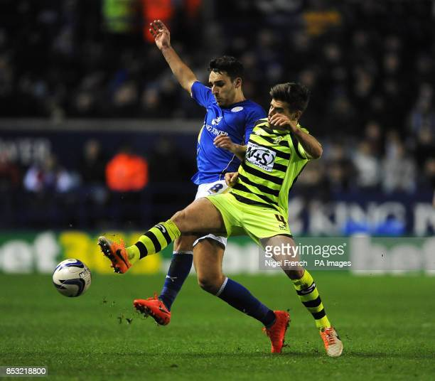 Leicester City's Matty James and Yeovil Town's Joe Edwards battle for the ball during the Sky Bet Championship match at the King Power Stadium...