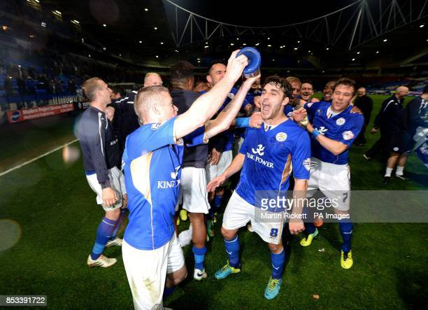 Leicester City's Matty James celebrates with team mates after they won their match and the Championship title following the Sky Bet Championship...