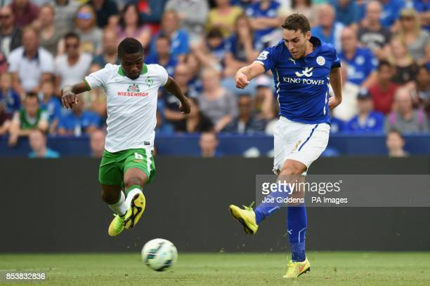 Leicester City's Matty James fires in a shot past Werder Bremen's Cedrick Makiadi during the preseason friendly at the King Power Stadium Leicester