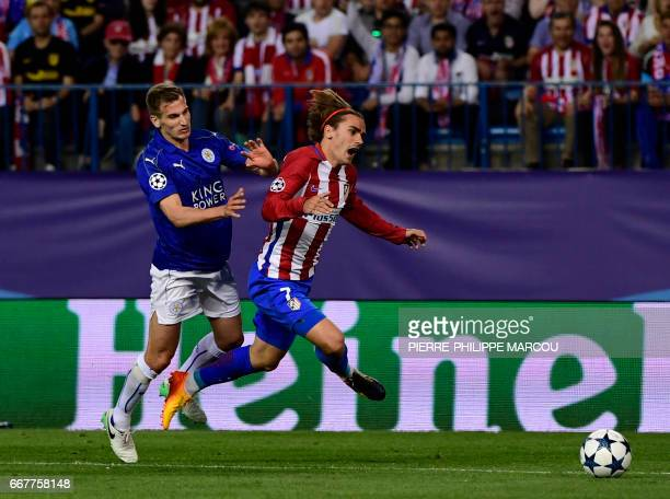 Leicester City's midfielder Marc Albrighton vies Atletico Madrid's French forward Antoine Griezmann during the UEFA Champions League quarter final...