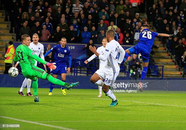 Leicester City's midfielder Riyad Mahrez scores the opening goal against Copenhagen during their Champions League Group G soccer match at the King...