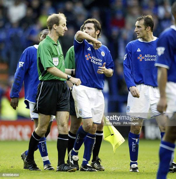 Leicester City's Muzzy Izzet complains to match referee Mike Riley over the sending off of teammate Matt Elliott during the Barclaycard Premiership...