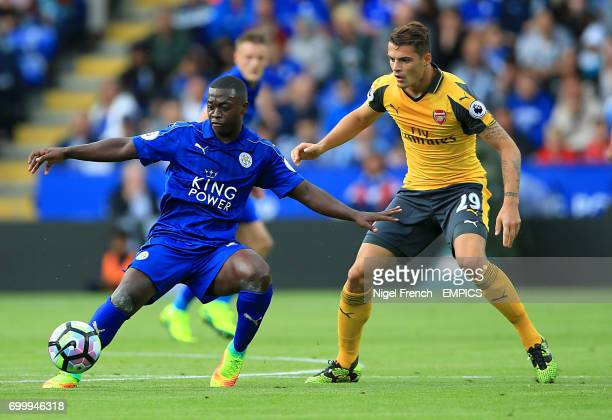 Leicester City's Nampalys Mendy and Arsenal's Granit Xhaka battle for the ball