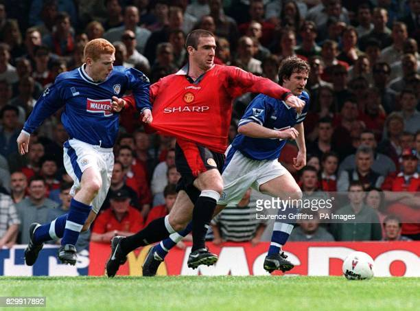 Leicester City's Neil Lennon in a midfield clash with Manchester United's Eric Cantona during today's Carling Premiership match at Filbert St Picture...