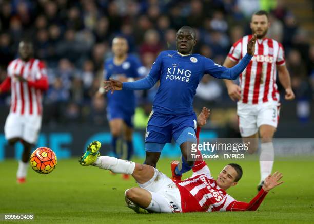 Leicester City's N'Golo Kante is tackled by Stoke City's Ibrahim Afellay