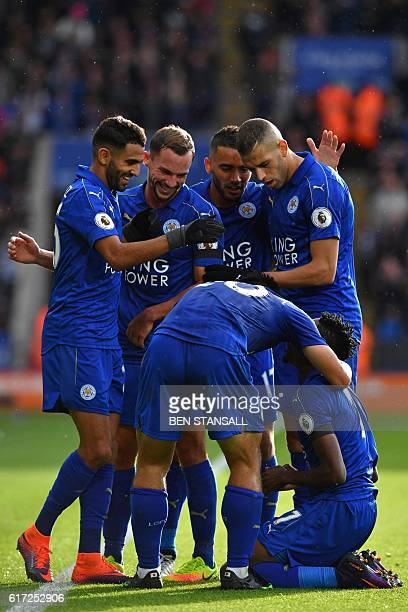 Leicester City's Nigerian midfielder Ahmed Musa celebrates with teammates after scoring the opening goal of the English Premier League football match...