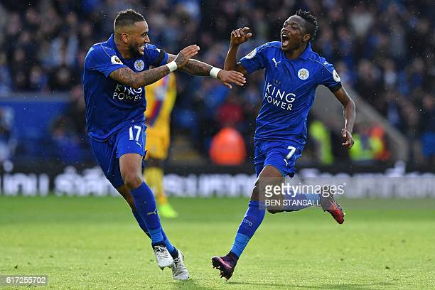 Leicester City's Nigerian midfielder Ahmed Musa celebrates with Leicester City's English defender Danny Simpson after scoring the opening goal of the...