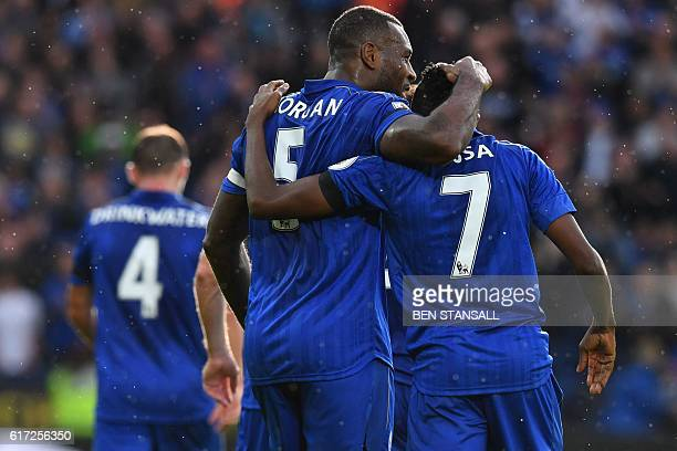 Leicester City's Nigerian midfielder Ahmed Musa celebrates with Leicester City's Englishborn Jamaican defender Wes Morgan after scoring the opening...
