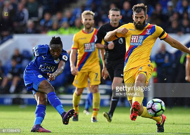Leicester City's Nigerian midfielder Ahmed Musa shoots past Crystal Palace's Welsh midfielder Joe Ledley to score the opening goal of the English...