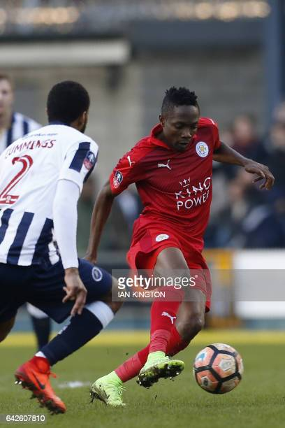 Leicester City's Nigerian midfielder Ahmed Musa vies with Millwall's Englishborn Jamaican defender Shaun Cummings during the English FA Cup fifth...