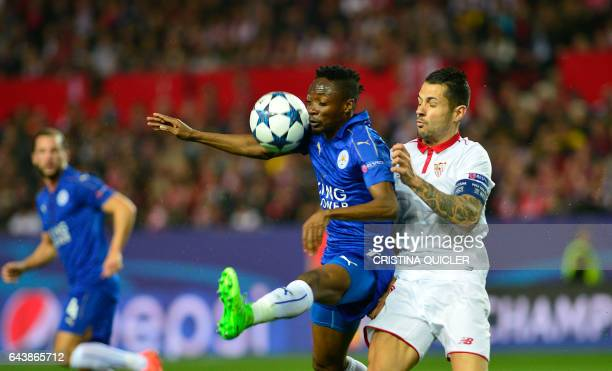Leicester City's Nigerian midfielder Ahmed Musa vies with Sevilla's midfielder Vitolo during the UEFA Champions League round of 16 second leg...