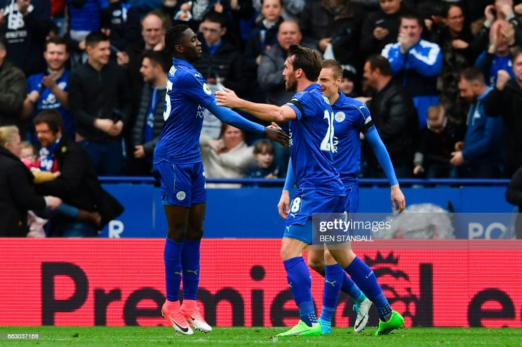 Leicester City's Nigerian midfielder Wilfred Ndidi (L) celebrates scoring the opening goal during the English Premier League football match between Leicester City and Stoke City at King Power Stadium in Leicester, central England on April 1, 2017. / AFP PHOTO / Ben STANSALL / RESTRICTED TO EDITORIAL USE. No use with unauthorized audio, video, data, fixture lists, club/league logos or 'live' services. Online in-match use limited to 75 images, no video emulation. No use in betting, games or single club/league/player publications. /