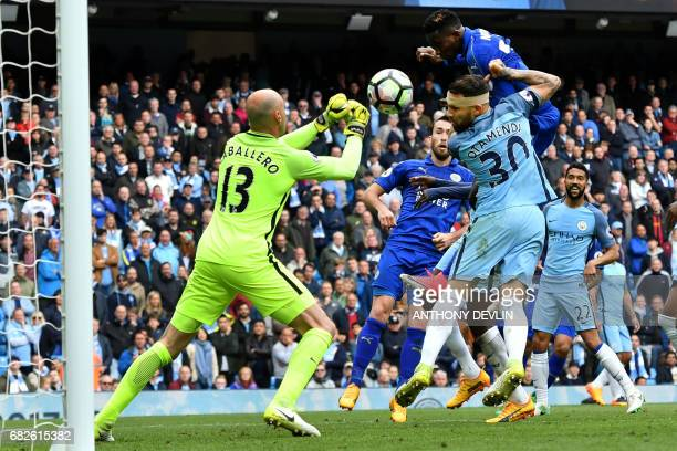 Leicester City's Nigerian midfielder Wilfred Ndidi has his header saved by Manchester CIty's Argentinian goalkeeper Willy Caballero during the...