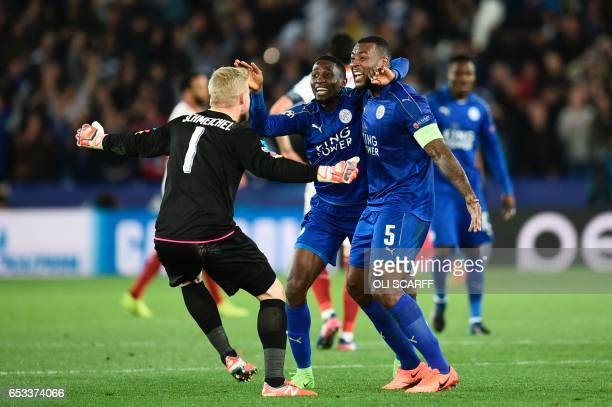Leicester City's Nigerian midfielder Wilfred Ndidi Leicester City's Englishborn Jamaican defender Wes Morgan and Leicester City's Danish goalkeeper...
