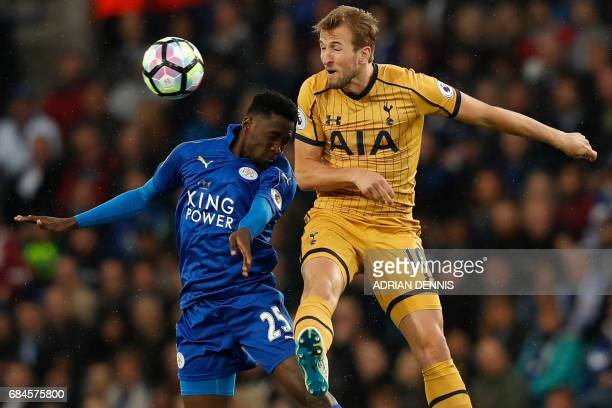 Leicester City's Nigerian midfielder Wilfred Ndidi vies with Tottenham Hotspur's English striker Harry Kane during the English Premier League...