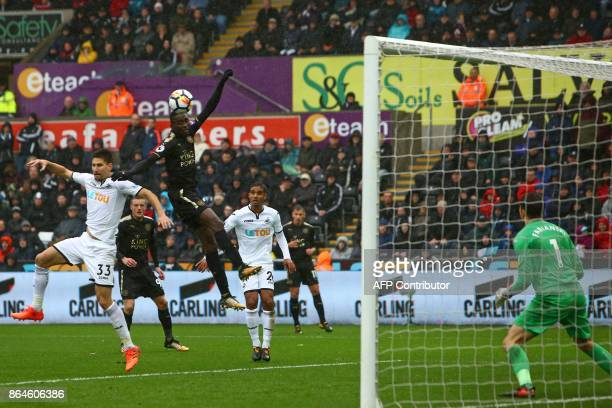Leicester City's Nigerian midfielder Wilfred Ndidi wins a header from Swansea City's Argentinian defender Federico Fernandez but Swansea City's...