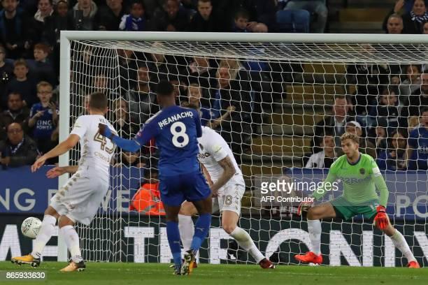 Leicester City's Nigerian striker Kelechi Iheanacho scores their first goal past Leeds United's German goalkeeper Felix Wiedwald during the English...