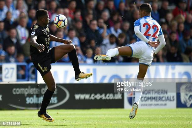 Leicester City's Nigerian striker Kelechi Iheanacho vies with Huddersfield Town's English midfielder Tom Ince during the English Premier League...