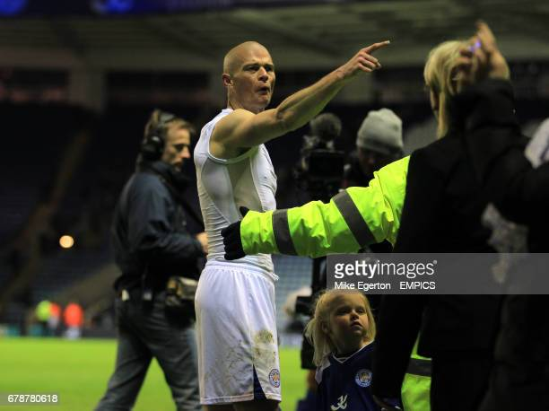 Leicester City's Paul Konchesky gets involved in an argument with a fan as he takes his children on a lap of honour