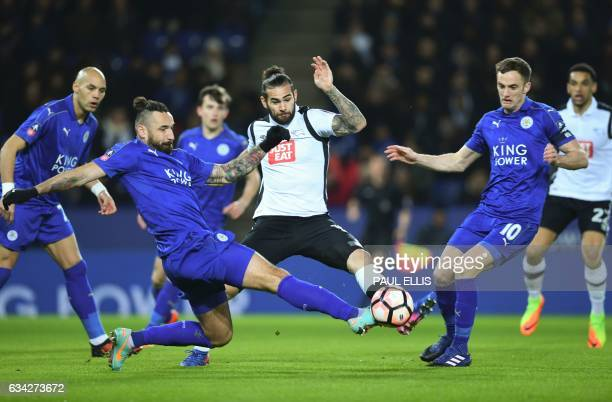 Leicester City's Polish defender Marcin Wasilewski and Derby's English midfielder Bradley Johnson vie for the ball during the English FA Cup fourth...