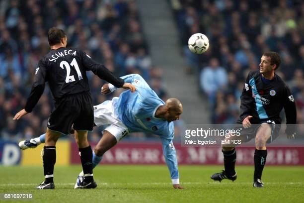Leicester City's Riccardo Scimeca and Billy McKinlay combine to stop Manchester City's Nicolas Anelka
