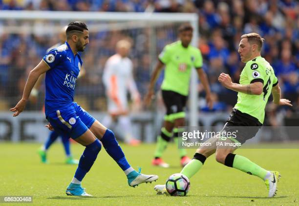 Leicester City's Riyad Mahrez and AFC Bournemouth's Dan Gosling battle for the ball during the Premier League match at the King Power Stadium...