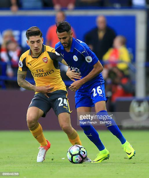 Leicester City's Riyad Mahrez and Arsenal's Nampalys Mendy battle for the ball