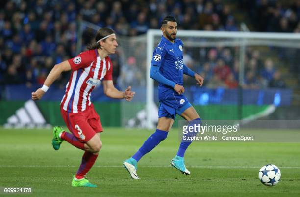 Leicester City's Riyad Mahrez and Atletico Madrid's Filipe Luis during the UEFA Champions League Quarter Final second leg match between Leicester...