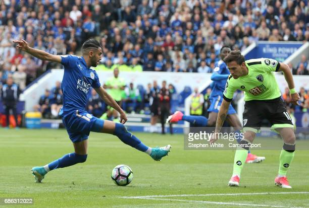 Leicester City's Riyad Mahrez and Bournemouth's Charlie Daniels during the Premier League match between Leicester City and AFC Bournemouth at The...