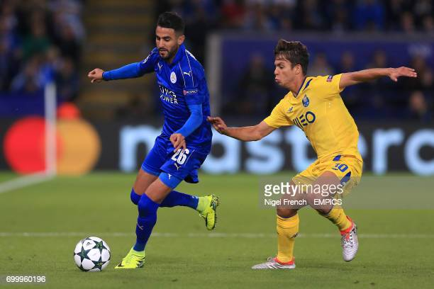 Leicester City's Riyad Mahrez and FC Porto's Miguel Andre Silva battle for the ball