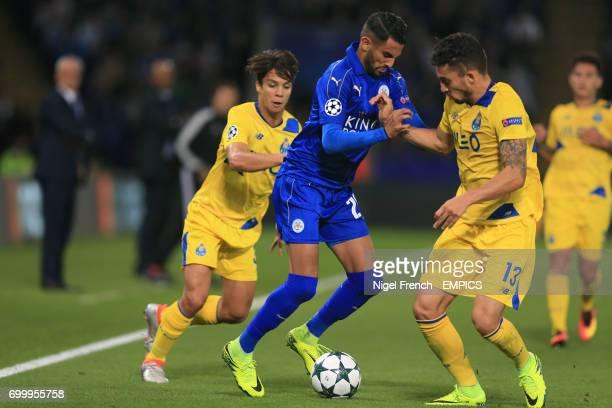 Leicester City's Riyad Mahrez and FC Porto's Nicolao Alex Telles battle for the ball
