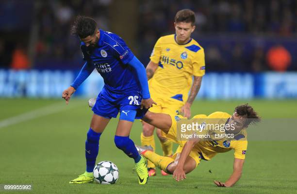 Leicester City's Riyad Mahrez and FC Porto's Oliver Torres battle for the ball