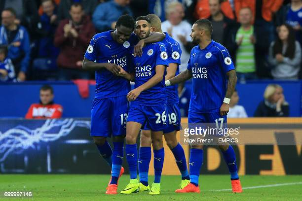 Leicester City's Riyad Mahrez and Leicester City's Daniel Amartey celebrate their side's third goal of the game which was given as a own goal