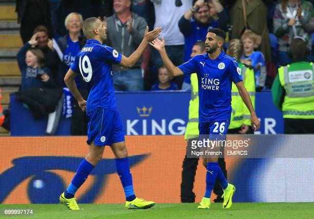 Leicester City's Riyad Mahrez and Leicester City's Islam Slimani clebrate their side's third goal of the game which was given as a own goal